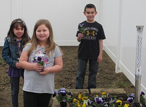 Greenhouse work creates young green thumbs