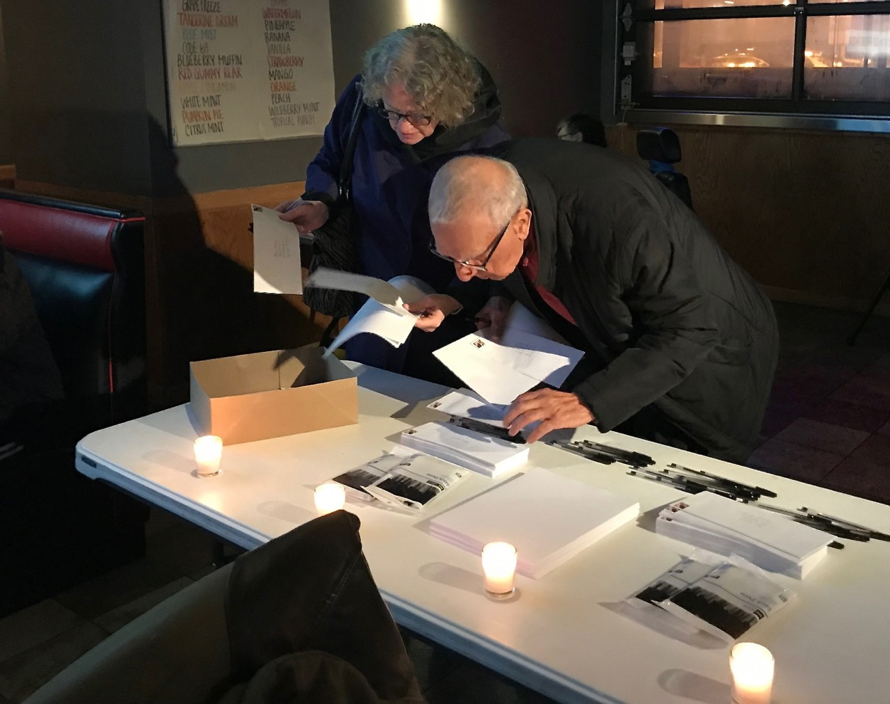 Supporters gather and write letters in support of Adi
