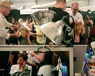 Models sit backstage for make up artists who design their looks, as they prepare to model the Nanette Lepore 2008 spring collection during Fashion Week in New York, Monday Sept. 10, 2007.