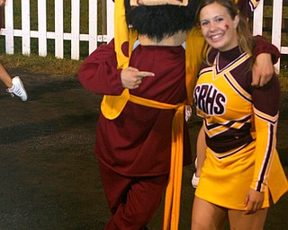The South Range Raider mascot finds senior cheerleader, Mandie Custer hanging out on the sidelines.