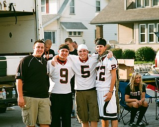 Girard Fans tailgate before the game.