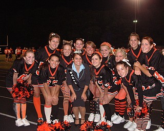 Congratulations Katie! Springfield High School Homecoming Queen Katie Bretz is surrounded by fellow cheerleaders at the game.