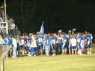 Bulldog fans celebrate with their team after a 56-7 victory over East Liverpool with the traditional singing of the Alma Mater.