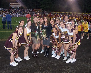 Two South Range Cheerleaders were chosen to represent their classes as Homecoming attendants at the Homecoming game Friday against United Local. Posing with their fellow cheerleaders are Courtney Driscoll, left (in brown) representing the Sophomore class and Christina Oddo, right (in black) representing the Junior class.