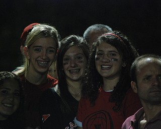 Here's a shot of Aleia Billic, Brielle Burton, Abby Malsch, and Maggie Bresnahan cheering on their Canfield Cardinals at homecoming!