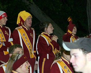 Patrick McLaughlin shows his school spirit with a bold Burgundy and Gold hat as he cheers with his friends Matt Venesky, Diana Rhodes, and Devon Parks.