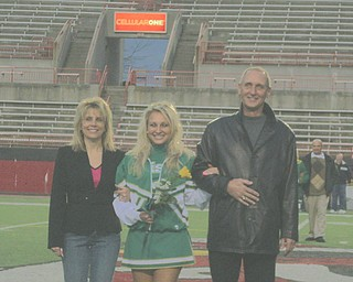 Pictures 409, DSCI0801 - The Olenick Family is full of smiles as they walk their daughter, Cheerleading Captain Katie Olenick, down Stambaugh Field on Ursuline High School's Senior Night!
