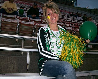 Anne Miller cheers on Ursuline's #9 her   brother Ross Revella