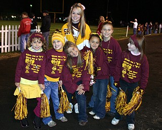 """""""Varsity Cheerleader Melissa Williams poses with her elementary cheerleading squad of 2nd graders."""""""