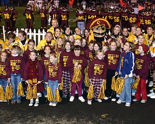 """""""South Range Raider Man stopped by to pose with some of the elementary cheerleaders and the high school cheerleaders."""""""