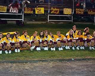 """""""It's Football Friday Night!"""" says the South Range Cheerleaders for the camera."""