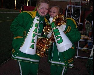 Kayla Spear & Ashley Williams wants to make sure the crowd hears them cheer on the Ursuline Irish so they huse their megaphones.