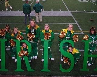 Ursuline Cheerleaders show their support to their fans by spelling out I-R-I-S-H.