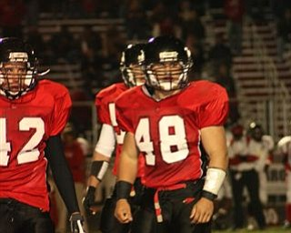These are pictures taken at Friday nights game against Marion-Franklin on November 2nd during Canfield's playoff victory. Number 10 is Mark Carrocce (quarterback) and number 48 is Dan Banna (fullback). GO CANFIELD !!!  YOU ARE #1  !!!!!