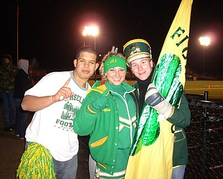 Katie Olenick and fellow classmates Steven Bernard and Louis Isabella show their team spirit. Go Irish!