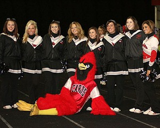 Canfield varsity cheerleaders take time to pose with their Cardinal mascot.