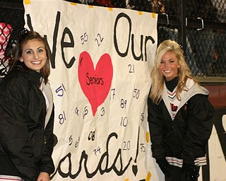 Seniors Allison Queen and Kaitlyn Brogley show their Cardinal pride with a