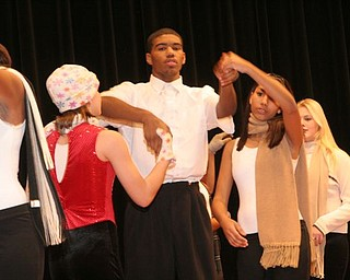 These are photos from Liberty High School's holiday concert, full choir and show choir.