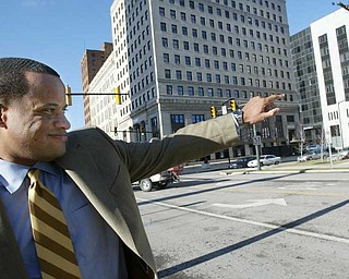 MAYORAL SUPPORT: Mayor Jay Williams waves to a passerby in downtown Youngstown. Williams calls the headway made by the city's demolition crews in demolishing vacant and abandoned buildings one of the most tangible successes to date.