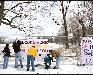 3.22.2008 Family and friends show their support for 23 marines, returning from a seven month deployment in Iraq, at the Youngstown Air Reserve Station in Vienna Saturday afternoon.