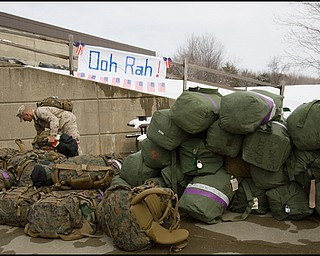 3.22.2008 LCPL Sandmann, grabs his gear after returning to the Youngstown Air Reserve Station in Vienna Saturday afternoon following a seven month deployment in Iraq.