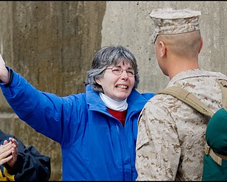 3.22.2008 Wendy Stanek, of Medina, welcomes her son, LCPL Gregory Stanek, as he returns from Iraq to the Youngstown Air Reserve Station in Vienna Saturday afternoon. Gregory is one of 23 marines who completed a seven month deployment with the Landing Support Equipment Company Marine Forces Reserve of the Youngstown Air Force Reserve.