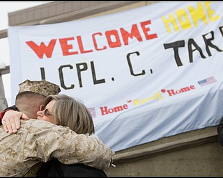 3.22.2008 Donna Tarr, of Willoughby, hugs her son, LCPL Chris Tarr, after his return to the Youngstown Air Reserve Station in Vienna following a seven month deployment in Iraq.