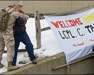 3.22.2008 David Dawson, of Chardon, hugs LCPL Chris Tarr as he returns to the Youngstown Air Reserve Station in Vienna Saturday afternoon following a seven month deployment in Iraq.