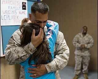 3.22.2008 Gunnery Sargeant Chuck Norris hugs his daughter, Sierra Norris , age 11 of Hermitage, at the Youngstown Air Reserve Station after a seven month deployment in Iraq.