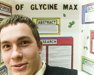 Michael Giles, 17, a student at Choffin CNTC, experimented with temperature on the rate of soy bean growth. He spent hours sculpting incubators out of styrofoam coolers and thrown-away plastic.