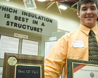 """For his interesting findings, gleaned from experiments on different types of insulation, Geneva High School student Braxton Wessell, 17, won the """"Best of Fair"""" award and a four-year scholarship to Youngstown State University.  The problem of insulating his families hog shed motivated Wessell to begin testing different heat-trapping materials. After weeks of trial and error, Wessell determined spray-foam insulation to be best at containing heat. A common household fabric material comes in second at a much lower cost. Surprisingly, pink fiberglass insulation was one of the least effective."""