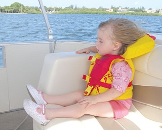 FIRST BOAT RIDE: McKenna Sweeney  of Boardman , 2 1/2 years old,  on  Seista Key, Florida.