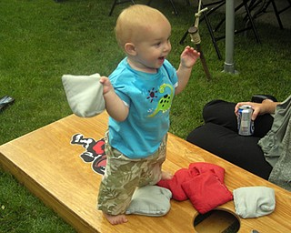 BABY DOM GOT GAME: Dominic Zitello , 1,  getting in on the Corn Hole Craze. Son of Brent and Lisa Zitello of Austintown.  Submitted by Grandma Dottie Zitello.