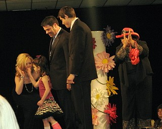 Kids and local celebrities model at the Angels of Easter Seals Spring Fashion Show