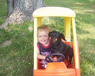 "Shelley Derrow's son, Tommy, enjoys a ""drive"" with Peanut."