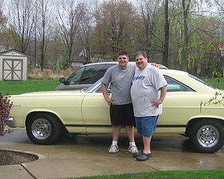Here are some pics of my husband - Mike Vallas, with out nephew - Matthew Vallas - in front of Mike's 1966 Mercury Cyclone Comet.  Matthew spent most of the day washing and waxing the car to take to Boardman's prom.   — Mary Vallas
