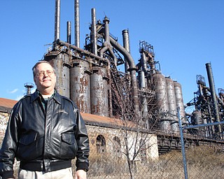 Ron Unger, director of advancement for the nonprofit ArtsQuest in Bethlehem, Pa., stands in front of the Bethlehem Steel plant. The structure will soon be incorporated into an entertainment center.