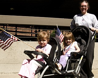 Jenn Quinlan of Boardman pushed daughters Adrianna, 4, left, and Genevieve, 3, the entire five mile with flags that must have decreased aerodynamics. Both girls made it clear that the concept of drag does not bother them.