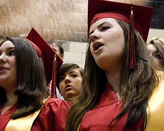 Valedictorian Pamela Galioto, left, and Amanda Clifton sing with the show choir.