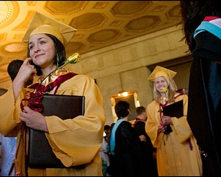 6.1.2008 Rebecca L. Illencik followed by Megan H. Kay exit Stambaugh Auditorium following Liberty High School's commencement ceremony Sunday afternoon.
