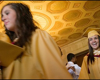 6.1.2008 Michelle Shriver (right) smiles as she exits Stambaugh Auditorium Sunday afternoon following Liberty High School's commencement ceremony Sunday afternoon.