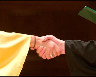 5.31.2008 A HANDSHAKE FOUR YEARS IN THE MAKING Ursuline High School Commencement at Stambaugh Auditorium Saturday morning.