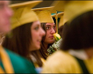 5.31.2008 Hannah Snyder smells a yellow rose during Ursuline High School's commencement ceremony at Stambaugh Auditorium Saturday morning.