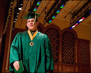 5.31.2008 Michael Paul Jenkins crosses the stage after receiving his diploma at Ursuline's Commencement Ceremony at Stambaugh Auditorium Saturday morning.
