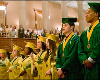 5.31.2008 George Williams (right) and Demetrios Kolitsos (left) stand with their fellow graduating seniors during the playing of the alma mater at Ursuline High School's 100th Commencement Ceremony in Stambaugh Auditorium.