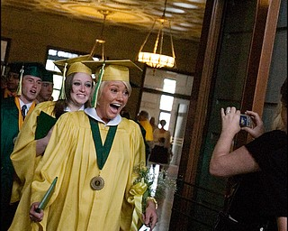 5.31.2008 Hannah Banks reacts to her photo being taken following Ursuline High School's commencement ceremony at Stambaugh Auditorium Saturday morning.