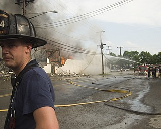 Fireman Daniel Holcomb, 28, of Youngstown two hours into battling the flea market fire.