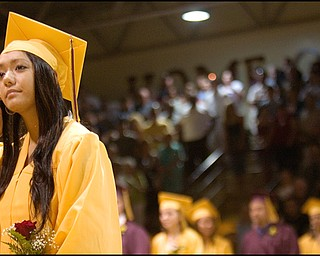 6.7.2008 Lokelani Elizabeth Mae Kalima waits to sit down as the fellow members of her South Range High School graduating class enter the gymnasium at South Range High School Saturday evening.