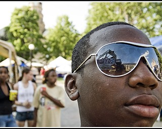 Markell Russell, 13, of Warren in his his new shades, checking out the Gyro stand.