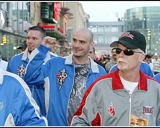 Kelly Pavlik flanked by corner man Mike Cox, left, and Team Pavlik member John Daltorio waling down to the boardwalk towards his fight with Gary Lockett